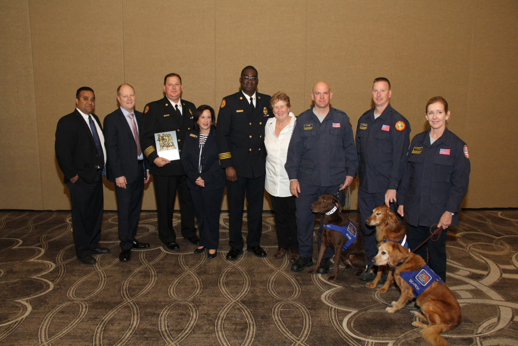 Terence Ramotar, AMR; David Sanford, AMR; Chief Dave Downey, Miami-Dade County Fire Rescue; Aventura Mayor Enid Weisman; Captain Rowan Taylor, Miami-Dade County Fire Rescue; Miami-Dade Comm. Sally Heyman; Urban Search & Rescue Chief Alan Perry with Zeus, Miami-Dade County Fire Rescue; Officer Greg Strickland with Indy; Retired Captain P.J. Parker with Chase